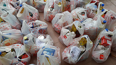 This photo shows bags filled with food items and hygiene material.