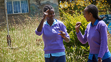 Two students of EECMY School for the Deaf chat in sign language in Ethiopia. 2018 ©CBM