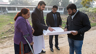 Reviewing a blueprint of the new eye hospital