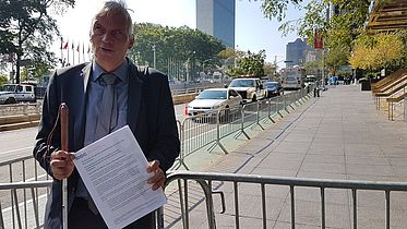 Michael Herbst stands in front of the UN General Assembly building in New York, U.S.A.