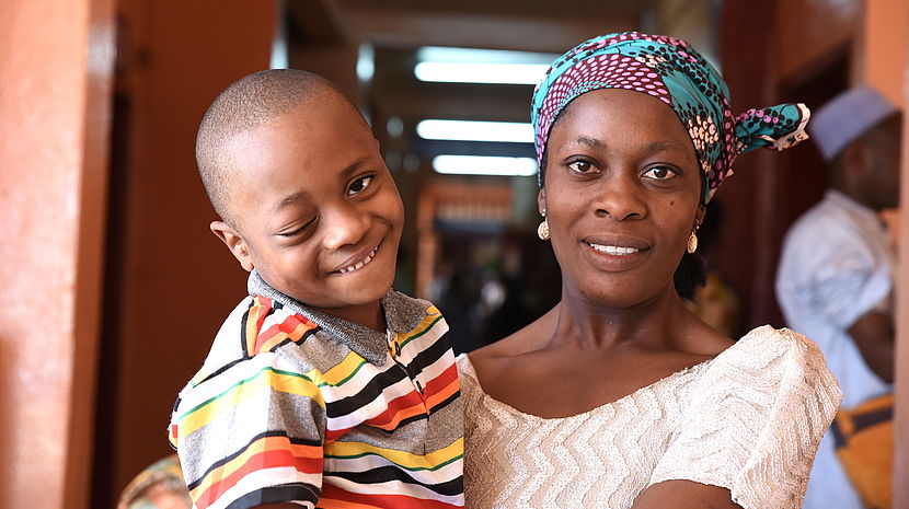 Happy 4-year-old Yazid in the arms of his mother, Ladifatou (30)