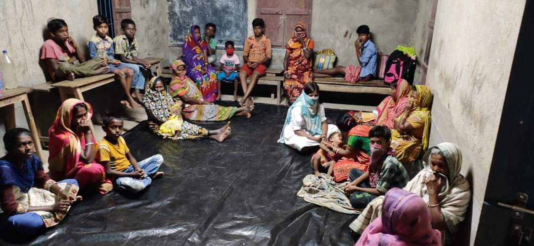 This photo shows a group of people sitting in a school classroom.